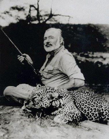 Hemingway being badass with a dead leopard.